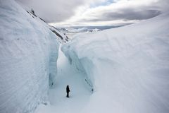 Man in the deep glacier crevasse - Arctic Stock Photography