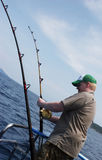 Man deep sea fishing Stock Photos
