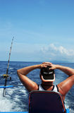 Man deep sea fishing Stock Image