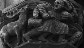 Man and deer. Shot in black and white. Placed on the facade of this historic building, sculpture on the capital representing man and deer. Set in Garraf, Sitges Stock Image