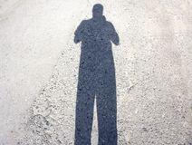 Man defeated by his shadow boxing.  Royalty Free Stock Photography