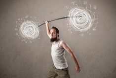 Man defeating chaos situation. Funny skinny guy defeating chaos situation Stock Image