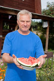 Man with a delicious sliced ​​red watermelon Stock Photo