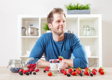 Man with delicious yogurt with fresh berries Stock Photo