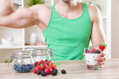 Man with delicious yogurt with fresh berries Stock Photos