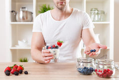 Man with delicious yogurt with fresh berries Royalty Free Stock Photo