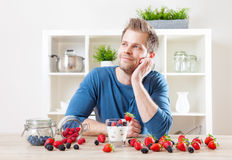 Man with delicious yogurt with fresh berries Stock Photography