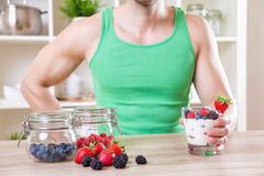 Man with delicious yogurt with fresh berries Royalty Free Stock Images