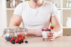 Man with delicious yogurt with fresh berries Stock Images