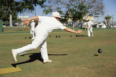 Man delivering ball. In lawn bowling Royalty Free Stock Image