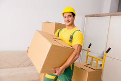 The man delivering boxes during house move. Man delivering boxes during house move stock photography