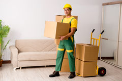The man delivering boxes during house move. Man delivering boxes during house move stock image