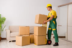 The man delivering boxes during house move Stock Photos
