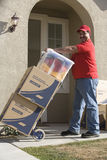 Man Delivering Boxes Into New House Royalty Free Stock Images