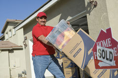 Man Delivering Cardboard Boxes Royalty Free Stock Image
