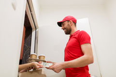 Man delivering coffee and food to customer home Stock Photos