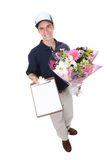 Man Delivering Flowers. A handsome young man delivering flowers isolated over white royalty free stock image