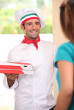 Man delivering fresh pizzas stock photo