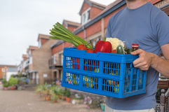Man is delivering groceries to the customer Stock Image