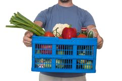 Man is delivering groceries to the customer. Isolated on white background.  stock image