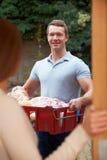 Man Delivering Online Grocery Order Stock Photo