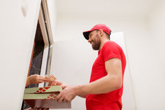 Man delivering pizza to customer and taking money Royalty Free Stock Image