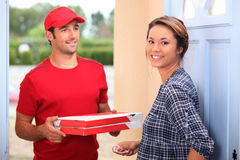 Man delivering pizza Stock Photos
