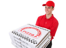 Man Delivering Pizzas. A handsome young man delivering pizzas isolated over white stock photo