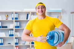 The man delivering water bottle to the office Royalty Free Stock Photo