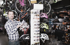 Man demonstrates  helmets for cycling Stock Images