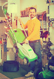 Man demonstrates a lawnmower Stock Image