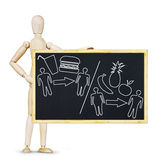 Man demonstrates the right food for healthy eating. Abstract image with wooden puppet stock images