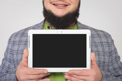Man demonstrates the tablet screen in both hands Royalty Free Stock Image