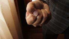 Man demonstrates two gold rings on his palm, then squeezes hand into a fist. Demonstrates two goldrings on his palm, then squeezes hand into a fist stock footage