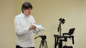 Man demonstrating drone quadcopter. In class stock footage