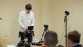 Man demonstrating electronic gimbal steadicam. With camera stock footage