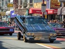 Man demonstrating his hydraulic low rider at the Carnaval Grand. SAN FRANCISCO, CA – MAY 27, 2018: Man demonstrating his hydraulic low rider at the royalty free stock images