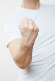Man demonstrating his strong fist. White background Royalty Free Stock Photography