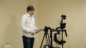 Man demonstrating mirrorless camera. On tripod in class stock footage