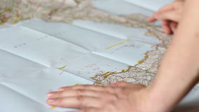Man demonstrating at a route. On a map stock footage
