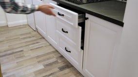 Man demonstrating soft closing kitchen drawers