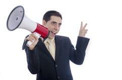 Man den iklädda dräkten och bind att ropa till och med megafonen Royaltyfri Foto