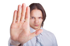 Man denies gesture. Business young man showing a gesture stop isolated on white background Royalty Free Stock Images