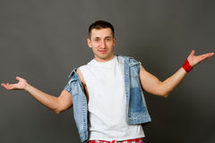 Man in a denim vest Stock Photography
