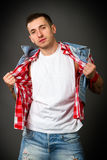 Man in a denim vest Stock Photos