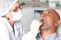 Man at the dentist Stock Photo