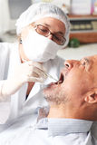 Man at the dentist Royalty Free Stock Photo