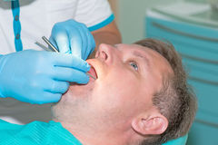 Man in dentist office doing annual check up Stock Photos