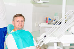 Man in dentist office horizontal Stock Photography