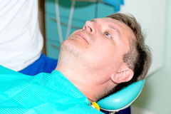 Man in dentist office waiting for procedure Royalty Free Stock Photography